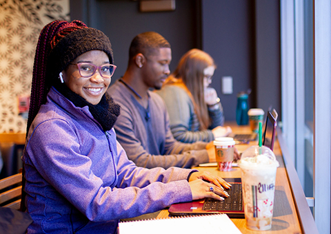 UWG student working on her laptop.